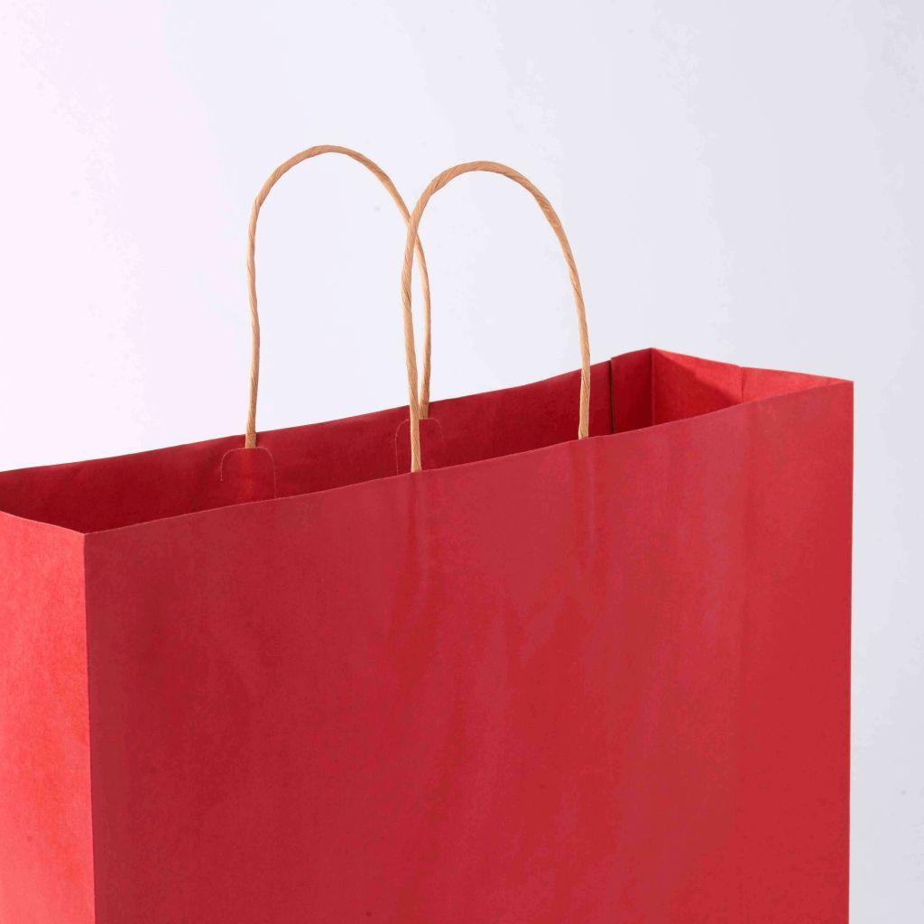Sacola de compras vermelha, fazendo referência ao ticket médio de compras que é uma métrica para e-commerce.